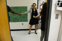 Princess Rodriguez greets a student outside her office. Rodriguez is the urban specialist at Raul Quintanilla Senior Middle School in Dallas.(Rose Baca - neighborsgo staff photographer)
