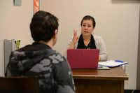 Rodriguez talks to a student in her office. The urban specialist position is a first for the district and focuses on dealing with cultural and urban issues in the classroom and returning students to school full-time.(Rose Baca - neighborsgo staff photographer)