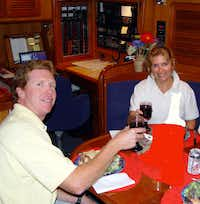 Alan and Liza Farrow-Gillespie, below deck on the Heartsong III off the coast of Gilbratar in 2004, spent six years sailing the world.