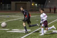 Lewisville's Van Cung (right) fights Coppell senior Kellen Reid for position on the ball during a Feb. 25 match between the two schools.DMN file photo - Staff Photographer