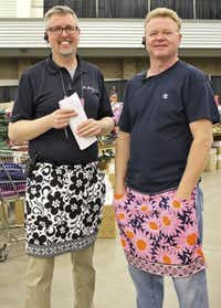 All of the workers at the Vera Bradley Outlet Sale wear aprons, even backstage stockers such as Brian Bates (left) and Scott Wall.( Betsa Marsh )