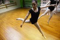 Carlee Baladez, 14, does a leap during ballet practice at Stage Door Dance ballet studio.( ROSE BACA/neighborsgo staff photographer )