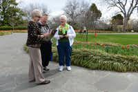 Jan Vestal, Dallas Arboretum volunteer, gives directions to David and Margie Friend during the Dallas Blooms Festival.