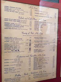 Vincent's Seafood put a menu from 1962 in a display case.( Maria Halkias  -  DMN staff photo )