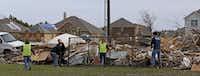 Volunteers help tornado victims remove debris in Garland, Texas, Friday, Jan. 1, 2016. (Jae S. Lee/The Dallas Morning News)