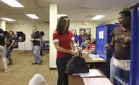 """First-time voter Veronica Owens, who became a citizen May 24, said voting was the last thing she needed to be """"100 percent part of this country."""""""