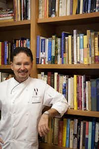 Chef Stephan Pyles with his in-home cookbook collection