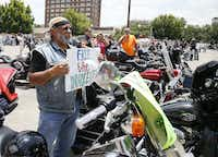 """Adam Valdez age 66, of Yoakum, Texas, arrives for the  """"All for 1"""" rally at the McLennan County courthouse parking lot in Waco, Texas, Sunday, June 7, 2015. Organizers, who have called the event a peaceful, silent protest, gathered in front of the courthouse to protest what they say is the violation of rights of many bikers who were arrested at Twin Peaks just for being at the scene of the crime. (Rod Aydelotte/Waco Tribune Herald via AP)(Rod Aydelotte - AP)"""