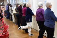 """Classes such as """"UpRight! Balance Training"""" help seniors prevent falls, which can cause bruises, fractured hips and head injuries and even lead to death. Older adults who fall once are twice as likely as their peers to fall again.( Photos by Matt McClain  -  The Washington Post )"""