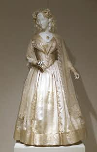 An exhibition in Denton of wedding gowns, including this one made in 1844, showcases the evolving styles of American brides.L.M. Otero  -  The Associated Press