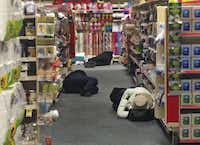 Stranded motorists rested in the aisles at a CVS pharmacy in Atlanta on Wednesday.