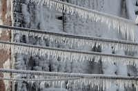 Icicles hang from utility and power lines near the scene of an overnight blaze in west Philadelphia, Monday, Feb. 16, 2015.(Jacqueline Larma - AP)