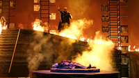"Wotan looms over the fire-guarded Brünnhilde in Washington National Opera's ""The Valkyrie."""