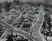 A 1976 aerial photograph shows the section of Dallas where Woodall Rodgers Freeway was to be constructed.