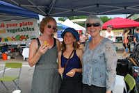Founder of the White Rock Local Market, Sarah Perry, left, enjoys a pastry with market managers L. Arielle Richman, center, and Sherry May.