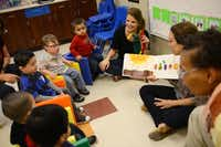 Perrin Koons (left), speech language pathologist, and Molly Schubert, speech therapy intern, read a book to kids during the Bridge Group class, with children ages 32 to 35 months, in the Early Childhood Intervention program at the Warren Center in Richardson. The Richardson-based nonprofit, which provides therapies for children with developmental differences or disabilities, recently began offering clinic-based services for children through age 5.Rose Baca - neighborsgo staff photographer