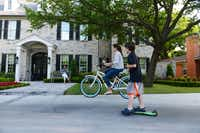 Grant Waco, 7, and his sister Avery, 13, play in the driveway of their University Park home, while their mother Gina Waco looks on. Waco and her husband opted to move from their lot in North Dallas to build a 5,000-square-foot house in place of an older 1950s home on Villanova Street.