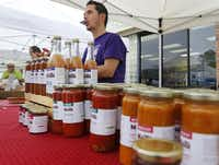 Gil Zafra sells Molli sauces at the White Rock Farmers Market in Dallas on May 9, 2015. (Rose Baca/The Dallas Morning News)( Rose Baca  -  Staff Photographer )