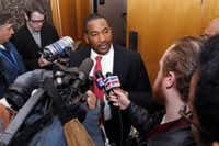Wilson, center, responds to questions after a court hearing in 2013.