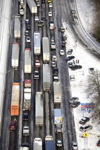Motorists on Interstate 75 in Atlanta got out of their vehicles to chat near abandoned cars along the ice-covered roadway Wednesday. One motorist reported taking 16 hours to travel 12 miles.