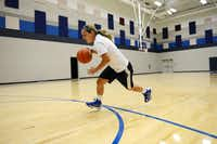 Sophomore basketball player Hannah Moya practices in one of the new gyms at Wylie East High School. Originally opened in 2007 as a freshman campus, construction on the school is finally complete. This year, the school will open with several additions, including two gyms, band hall, field house, science classrooms and career and technology classrooms.