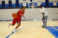 Junior basketball player Jazmin Shields practices in one of the new gyms at Wylie East High School, while Julian Stephens looks on. Originally opened in 2007 as a freshman campus, construction on the school is finally complete. This year, the school will open with several additions, including two gyms, band hall, field house, science classrooms and career and technology classrooms.