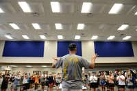 Band director Glenn Lambert conducts students during a band practice in the new band hall at Wylie East High School. Originally opened in 2007 as a freshman campus, construction on the school is finally complete. This year, the school will open with several additions, including two gyms, band hall, field house, science classrooms and career and technology classrooms.