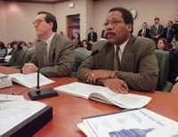 Dale Craymer, left, testifies as a budget adviser to then-Gov. George W. Bush. (1997 AP File Photo/George Bridges)