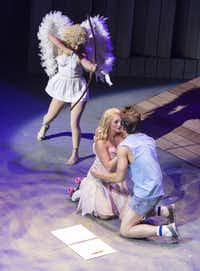"Cupid shoots an arrow at Brittany Dnielle and Sean McGee during the performance of ""Xanadu"" at the Water Tower Theatre in Addison, Texas, Monday, July 29, 2013."
