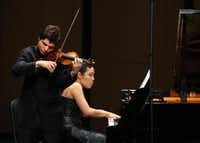 Violinist Augustin Hadelich and pianist Joyce Yang have become area favorites. Their Chamber Music International recital wowed.(Brad Loper - Staff Photographer)