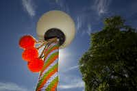 Three light poles and a street sign outside the Lakewood Branch Library in Dallas have been yarn bombed.