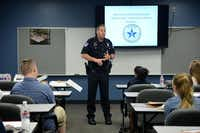 Community liaison officer Lee Rhinebarger with the Richardson Police Department speaks to students during the Youth Citizen Police Academy held in Plano last week. Similar to the program for adults, the week-long program focused on providing students ages 14 to 17 with insight into how and why the police department operates.(Rose Baca - neighborsgo staff photographer)