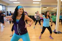 Sylvia Bernal dances during one of Elliott's Zumba classes.(Rose Baca - neighborsgo staff photographer)