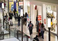 Holiday shoppers make their way through Town East Mall on Wednesday, December 17, 2014. (Ashley Landis/The Dallas Morning News)(Ashley Landis - Staff Photographer)