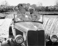"""Then U.S. Senator and former U.S. President Lyndon B. Johnson and Lady Bird Johnson cross the Pedernales River in their 1934 Ford """"Deluxe Phaeton"""" convertible on the LBJ ranch near Stonewall, Texas, in this December, 1959 file photo. Former first lady Lady Bird Johnson has died in Austin, Texas at the age of 94, less than two weeks after leaving hospital, a family spokeswoman said on July 11, 2007."""