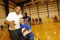 GRANT HILL , a former NBA star, coached special-needs kids in a basketball camp in Dallas as part of the Final Four festivities.Photos by RICHARD W. RODRIGUEZ - Richard W. Rodriguez
