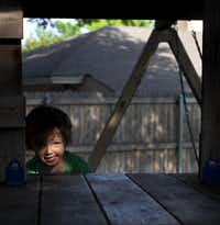 Two-year-old Abby Isakson played in her treehouse at home in Plano on Wednesday.