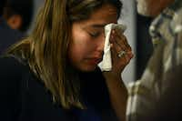Carmen Osowski of Brownsville, Texas, wipes tears from her face after the process of adopting three daughters during National Adoption Day at the Henry Wade Juvenile Justice Center in Dallas on Saturday Nov. 21, 2015. (Rachel Woolf/The Dallas Morning News)