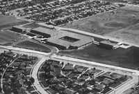 In this aerial shot from 1966, Neighborhoods and empty space ring Bishop Lynch High School. Roffino Stadium wasn't built yet (it opened in 1968) and several campus buildings have been added over the years.