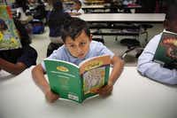 First-grader Joseph Avila attends the after-school program at Dunbar Learning Center.( Rose Baca  -  Staff Photographer )