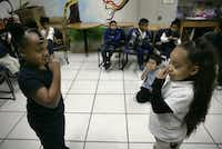 Tatianna Seaton, 6 (left), and Naomi Moore, 5, mirror each other in Creative Dramatics class.