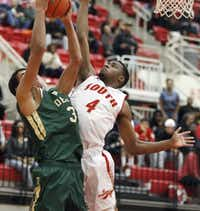 DeSoto junior forward Brandon Rushing (31) attempts a shot as South Grand Prairie junior guard Jordan Dansby (4) defends during the first half of a high school boys basketball game at South Grand Prairie High School, Tuesday, January 13, 2015. (Brandon Wade/Special Contributor)(Brandon Wade - Special Contributor)