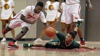 South Grand Prairie junior guard Cameron Foreman (3) and DeSoto senior guard Ed Dennis, right, battle for a loose ball during the first half of a high school boys basketball game at South Grand Prairie High School, Tuesday, January 13, 2015. (Brandon Wade/Special Contributor)(Brandon Wade - Special Contributor)