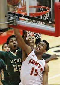 South Grand Prairie senior guard Jordan Horton (15) attempts a layup as DeSoto junior  forward Marques Bolden (22) defends during the first half of a high school boys basketball game at South Grand Prairie High School, Tuesday, January 13, 2015. (Brandon Wade/Special Contributor)(Brandon Wade - Special Contributor)