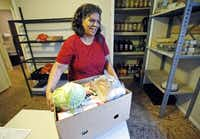 Linda Hernandez of Wylie picked up food from the Amazing Grace Food Pantry in St. Paul. A fire dealt a blow to the ministry and Cristo es Rey church.Stewart F. House - Special Contributor