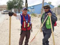 J. Isabel Arrellano (left), 64, and Juan Manuel Zepeda, 42, have a message for Islamic State militants reported to have taken up residence: Grab a broom and get to work.(Alfredo Corchado -  Staff  )