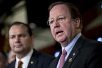 Rep. Bill Flores, R-Bryan, (right) and Sen. Mike Lee, R-Utah, (left) at a press conference in February on funding for the Department of Homeland Security. (Andrew Harrer/Bloomberg)