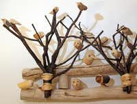 Tiny carved birds on twigs is a piece of folk art found in a Santa Fe gallery.KELLEY CHINN  -  Special Contributor