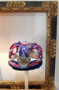The crown is a bit of folk art made from bits of colored cloth. The gilded picture frame, even empty, has plenty of decorative value.KELLEY CHINN  -  Special Contributor