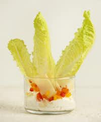 CAESAR DIP BY THE GLASS: Pour enough Caesar salad dressing in the glass to come up the sides 1/4 to 1/2 inch. Add (standing on end) 3 small, inner romaine leaves. Add shaved Parmigiano-Reggiano and finely diced red and yellow bell pepper.